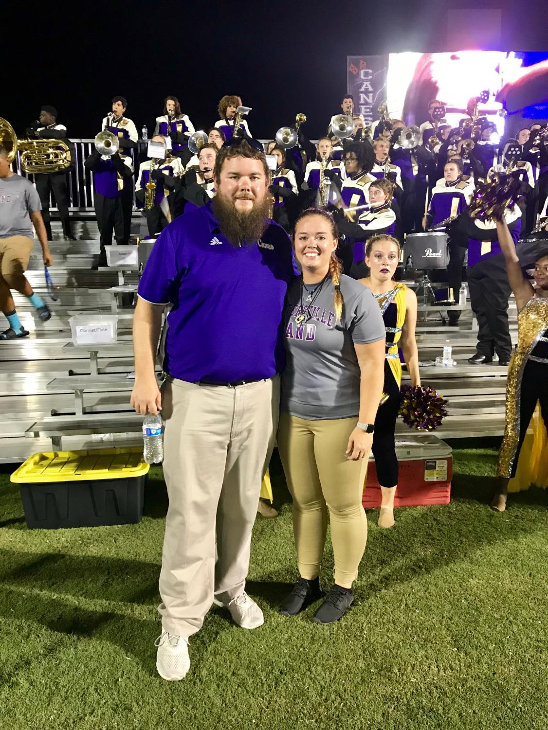 Mr. Shive, left, and Ms. Lanier, right, pose in front of the band.