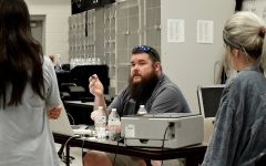 RANDY PARKER/THE DAILY TRIBUNE NEWS Cartersville High School Band Director Alex Shive speaks with members of his student leadership team in the school's band room.