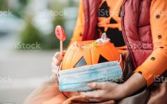 Little girl trick or treating during COVID-19 pandemic.