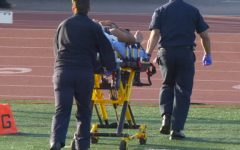 A player is injured while playing American football. - Slow Motion